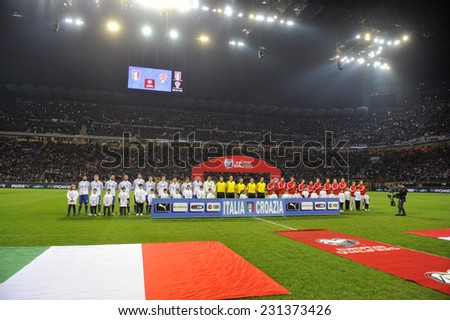MILAN, ITALY-NOVEMBER 16, 2014: soccer teams during national anthems, during the international soccer match Italy vs Croatia at the san siro stadium, in Milan. - stock photo