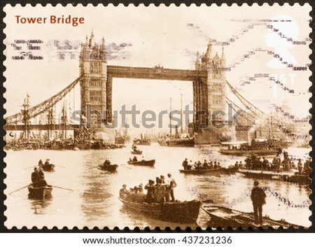 Milan, Italy - November 11, 2014: Stamp with old picture of Tower Bridge in London