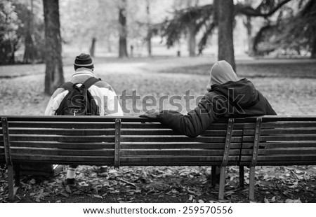 MILAN, ITALY - NOVEMBER, 24: View of two black people sitting on the bench on November 24, 2014 - stock photo