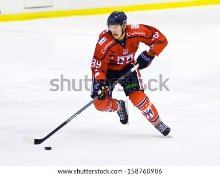 MILAN, ITALY - OCT 10:Adam Estoclet  of HC Milano during a game against the Valpellice at  Agora Arena on October 10, 2013, in Milan, Italy. - stock photo