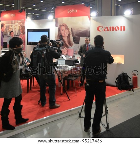 MILAN, ITALY - OCT. 19: Interview at Canon technologies stand during SMAU, international fair of business intelligence and information technology on October 19, 2011 in Milan, Italy.