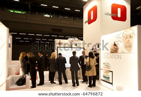 MILAN, ITALY - OCT. 21: Olivetti stand during SMAU, International Exhibition of Information and Communication Technology on October 20, 2010 in Milan, Italy. - stock photo