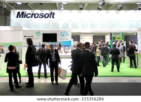 MILAN, ITALY - OCT. 19: People visit Microsoft technologies exhibition area at SMAU, international fair of business intelligence and information technology October 19, 2011 in Milan, Italy. - stock photo