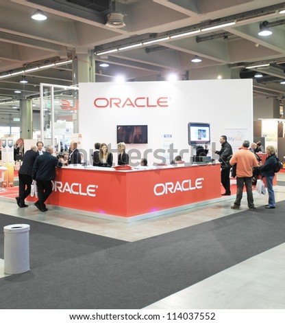 MILAN, ITALY - OCT. 19: People visiting Oracle technologies area during SMAU, international fair of business intelligence and information technology October 19, 2011 in Milan, Italy. - stock photo