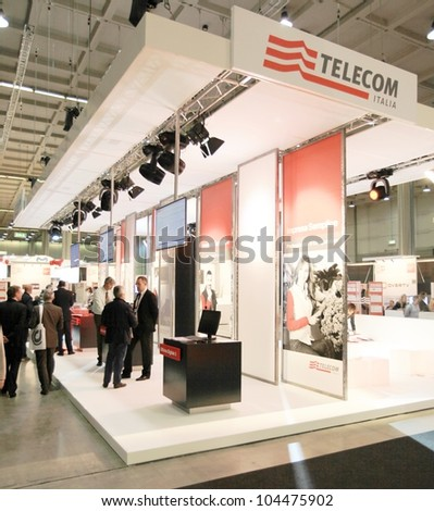 MILAN, ITALY - OCT. 19: People visiting Telecom technologies area during SMAU, international fair of business intelligence and information technology October 19, 2011 in Milan, Italy. - stock photo