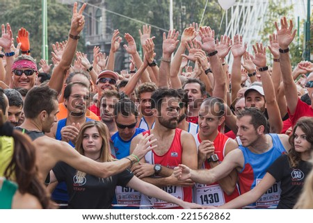 MILAN, ITALY - OCTOBER 5: Athletes take part in Deejay Ten, running event organized by Deejay Radio through the city streets on OCTOBER 5, 2014 in Milan.