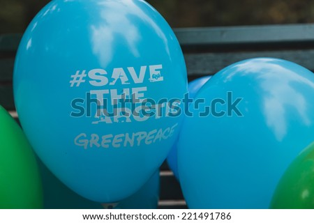 MILAN, ITALY - OCTOBER 4: Balloons at the Ice Ride, global bike event organized by Greenpeace to demand protection for the Arctic on OCTOBER 4, 2014 in Milan. - stock photo