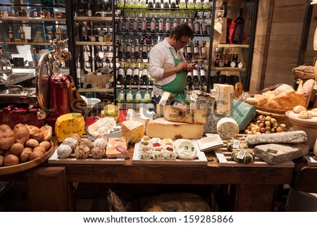 MILAN, ITALY - OCTOBER 18: Different kind of Italian cheese at Host 2013, international exhibition of the hospitality industry on OCTOBER 18, 2013 in Milan. - stock photo