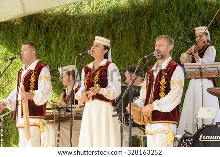 MILAN, ITALY - October 07, EXPO 2015,  traditionally dressed up musicians play outside the Belarus Pavilion 02, shot  on oct 07 2015  Milan, Italy