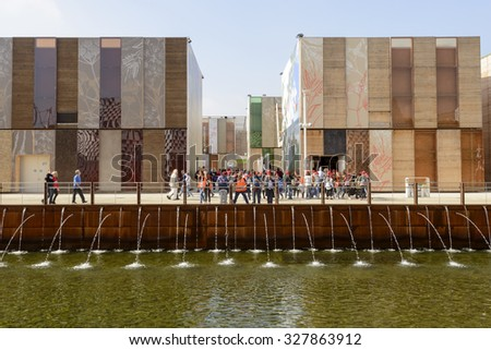 MILAN, ITALY - October 07, EXPO 2015, view of decorated facades of Spice cluster pavilions prospecting on a ditch with gushing water, shot  on oct 07 2015  Milan, Italy