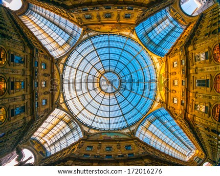 MILAN, ITALY - OCTOBER 30: Glass roof of Vittorio Emmanuele II shopping gallery on October 30, 2013 in Milan, Italy. Built in 1875 this gallery is one of the most popular shopping areas in Milan. - stock photo