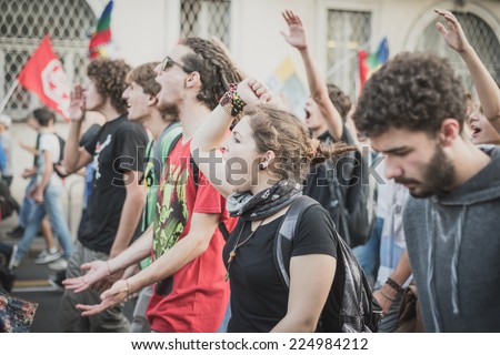 MILAN, ITALY - OCTOBER 18: manifestation held in Milan october 18, 2014. People took streets to protest against racism, war and against lega nord, right wing politic italian movement