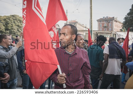 MILAN, ITALY - OCTOBER 18: manifestation held in Milan october 18, 2014. People took streets to protest against racism, war and against lega nord, right wing politic italian movement - stock photo