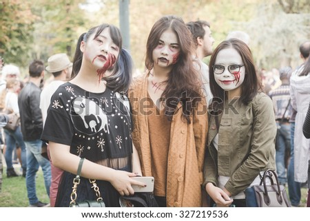 MILAN, ITALY - OCTOBER 10: People during Milan Zombie Walk, Italy on OCTOBER 10, 2015. People dressing and disguised like zombie marching during Milan Zombie Walk