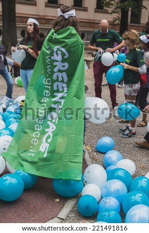 MILAN, ITALY - OCTOBER 4: People take part in the Ice Ride, global bike event organized by Greenpeace to demand protection for the Arctic on OCTOBER 4, 2014 in Milan. - stock photo