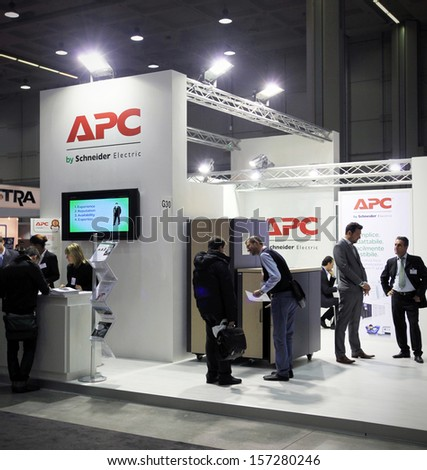 MILAN, ITALY - OCTOBER 17: People visit APC  technology products exhibition area at SMAU, international fair of business intelligence and information technology October 17, 2012 in Milan, Italy.  - stock photo
