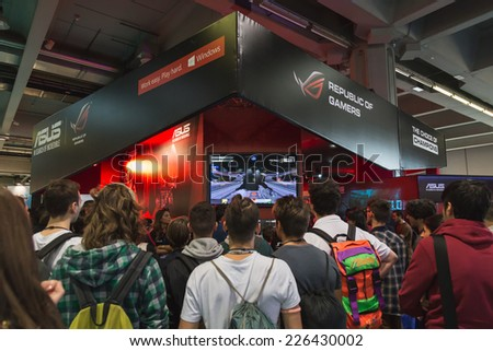 MILAN, ITALY - OCTOBER 24: People visit Games Week 2014, event dedicated to video games and electronic entertainment on OCTOBER 24, 2014 in Milan. - stock photo