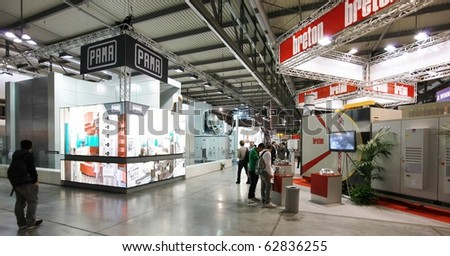MILAN, ITALY - OCTOBER 08: People visit stands at Sfortec 2010, international exhibition of machines, robots, automation and auxiliary technologies October 08, 2010 in Milan, Italy.
