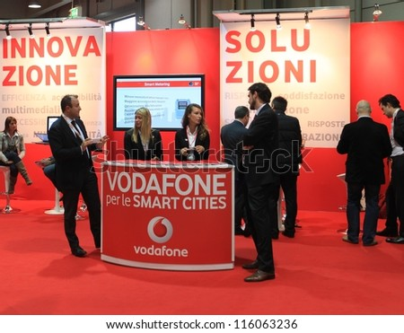 MILAN, ITALY - OCTOBER 17: People visit Vodafone technology products exhibition area at SMAU, international fair of business intelligence and information technology October 17, 2012 in Milan, Italy. - stock photo