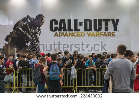 MILAN, ITALY - OCTOBER 24: People wait to enter Call of Duty stand at Games Week 2014, event dedicated to video games and electronic entertainment on OCTOBER 24, 2014 in Milan. - stock photo