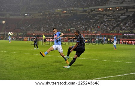 MILAN, ITALY-OCTOBER 19,2014: players Juan Jesus and Marek Hamsik in action during the Italian serie A night soccer match FC Internazionale vs  Napoli at the san siro stadium, in Milan. - stock photo