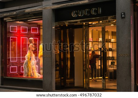 Milan, Italy - October 9, 2016: Shop window and entrance of a Gucci shop in Milan - Montenapoleone street, Italy. Few days after Milan Fashion Week. Fall Winter 2017 Collection.
