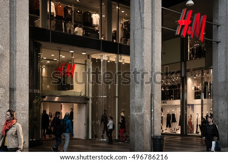 Milan, Italy - October 9, 2016: Shop window and entrance of a H&M shop in Milan, Italy. Few days after Milan Fashion Week. Fall Winter 2017 Collection.