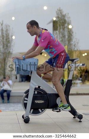 MILAN, ITALY-OCTOBER 05, 2015: stationary bike fitness trainer during an open exercise lesson inside the EXPO area, in Milan.