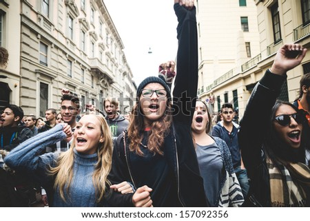 MILAN, ITALY - OCTOBER 4: Students manifestation held in Milan on October, 4 2013. Students took to the streets to protest against italian austerity, against italian crisis and claiming their future - stock photo