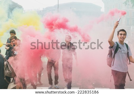 MILAN, ITALY - OCTOBER 10: Thousands of students march in the city streets to protest against the money cuts in the public school on OCTOBER 10, 2014 in Milan. - stock photo