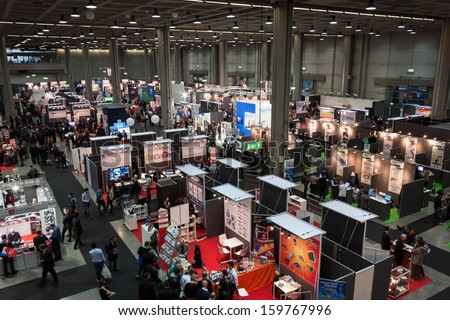 MILAN, ITALY - OCTOBER 23: Top view of people and booths at Smau, international exhibition of information communications technology on OCTOBER 23, 2013 in Milan. - stock photo