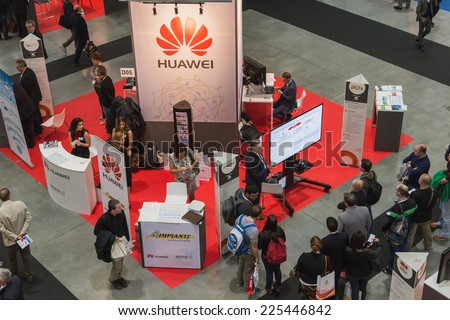 MILAN, ITALY - OCTOBER 22: Top view of people and booths at Smau, international exhibition of information communications technology on OCTOBER 22, 2014 in Milan. - stock photo
