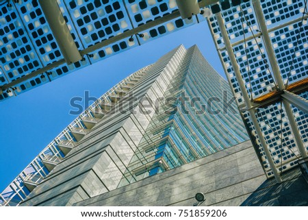 MILAN, ITALY - OCTOBER 9, 2017: View of the Unicredit skyscraper tower complex, Piazza Gae Aulenti in the business district of Porta Garibaldi, cool toned