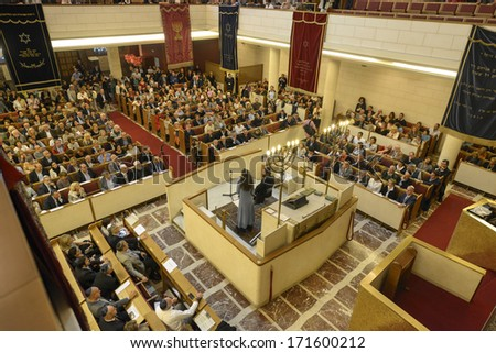 MILAN, ITALY - SEPTEMBER 29: A jewish lesson during the Jewish City Festival  inside the synagogue in Milan September, 29 2013. - stock photo