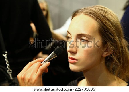 MILAN, ITALY - SEPTEMBER 20: A model getting ready backstage before the Mila Schon fashion show as part of Milan Fashion Week Womenswear Spring-Summer 2015 on September 20, 2014 in Milan, Italy.