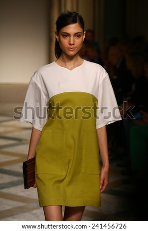 MILAN, ITALY - SEPTEMBER 17: A model walks runway during the Chicca Lualdi show as a part of Milan Fashion Week Womenswear Spring/Summer 2015 on September 17, 2014 in Milan, Italy. - stock photo