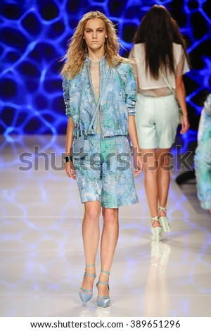 MILAN, ITALY - SEPTEMBER 25: A model walks the runway during the Aigner fashion show as part of Milan Fashion Week Spring/Summer 2016 on September 25, 2015 in Milan, Italy.