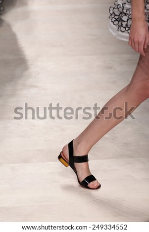MILAN, ITALY - SEPTEMBER 19: A model walks the runway during the Blumarine show as a part of Milan Fashion Week Womenswear Spring/Summer 2015 on September 19, 2014 in Milan, Italy