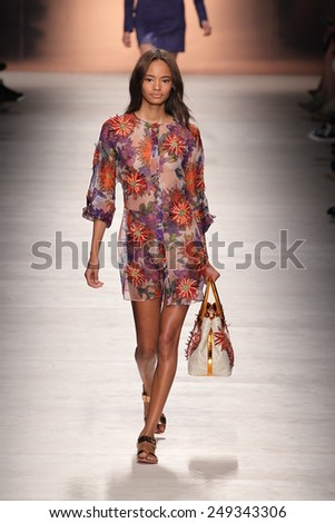 MILAN, ITALY - SEPTEMBER 19: A model walks the runway during the Blumarine show as a part of Milan Fashion Week Womenswear Spring/Summer 2015 on September 19, 2014 in Milan, Italy - stock photo