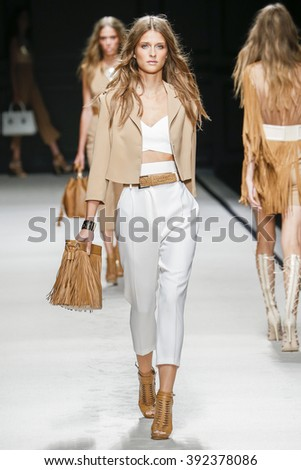 MILAN, ITALY - SEPTEMBER 26: A model walks the runway during the Elisabetta Franchi fashion show as part of Milan Fashion Week Spring/Summer 2016 on September 26, 2015 in Milan, Italy.  - stock photo