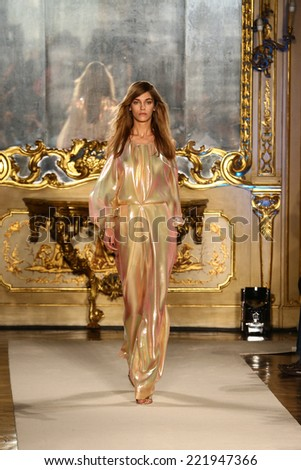 MILAN, ITALY - SEPTEMBER 20: A model walks the runway during the Genny show as part of Milan Fashion Week Womenswear Spring-Summer 2015 on September 20, 2014 in Milan, Italy.