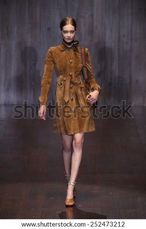 MILAN, ITALY - SEPTEMBER 17: A model walks the runway during the Gucci show as a part of Milan Fashion Week Womenswear Spring/Summer 2015 on September 17, 2014 in Milan, Italy. - stock photo