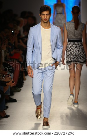 MILAN, ITALY - SEPTEMBER 21: A model walks the runway during the Massimo Rebecchi show as part of Milan Fashion Week Womenswear Spring 2015 on September 21, 2014 in Milan, Italy. - stock photo