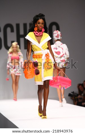 MILAN, ITALY - SEPTEMBER 18: A model walks the runway during the Moschino show as part of Milan Fashion Week Womenswear Spring/Summer 2015 on September 18, 2014 in Milan, Italy.  - stock photo