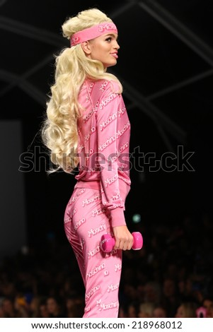 MILAN, ITALY - SEPTEMBER 18: A model walks the runway during the Moschino show as part of Milan Fashion Week Womenswear Spring/Summer 2015 on September 18, 2014 in Milan, Italy.
