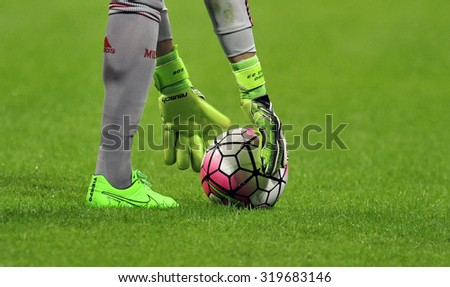 MILAN, ITALY-SEPTEMBER 13, 2015: AC Milan goalkeeper holding the ball from the pitch during the milanese derby FC Internazionale vs AC Milan at the San Siro stadium, in Milan.