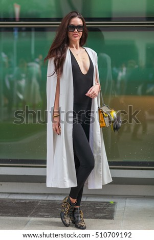 MILAN, ITALY - SEPTEMBER 23: Fashionable woman poses after ARMANI fashion show during Milan Women's Fashion Week Day 3, street style on SEPTEMBER 23, 2016 in Milan.