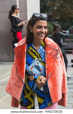 MILAN, ITALY - SEPTEMBER 22, 2016: Fashionable woman poses outside Pucci fashion show building during Milan Women Fashion Week SS17.
