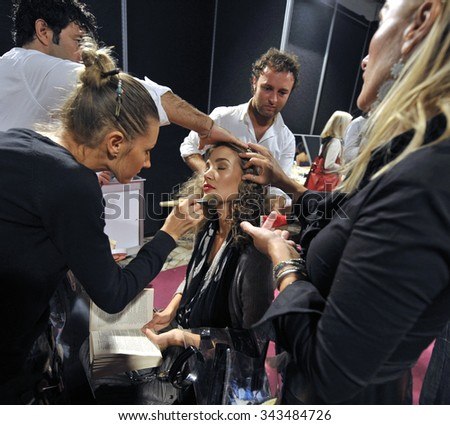 MILAN, ITALY-SEPTEMBER 28, 2009: female models on backstage of a fashion show, in Milan. - stock photo