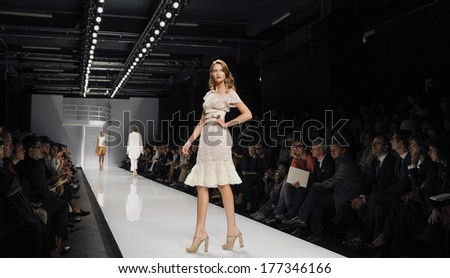 MILAN,ITALY-SEPTEMBER 28, 2009: Models runway catwalk during the Mariella Burani spring-summer fashion collection. - stock photo